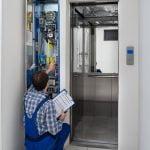Man repairing elevator