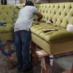 Man repairing Furniture