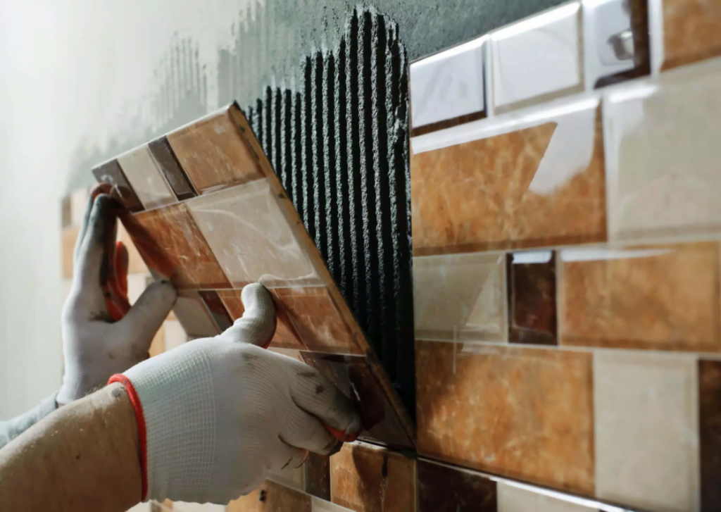 The man who is doing tiling
