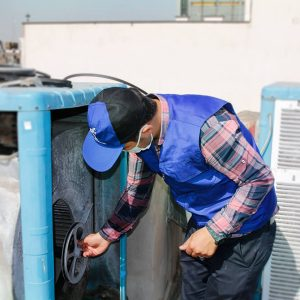 The man who is repairing the water cooler